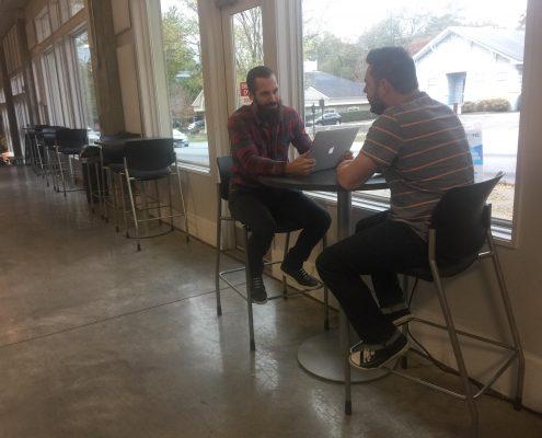 Addison & Kevin Talking Marketing At Table